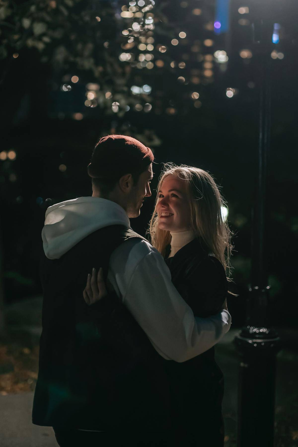 couple outside at night smiling