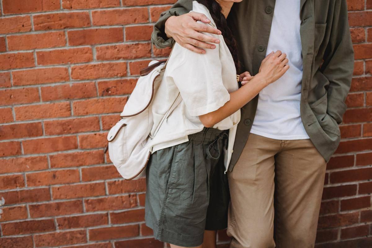 faceless couple hugging