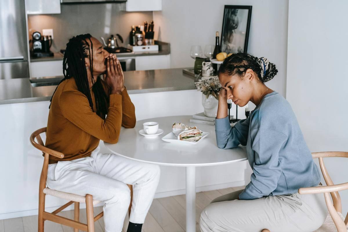 couple is sad around kitchen table