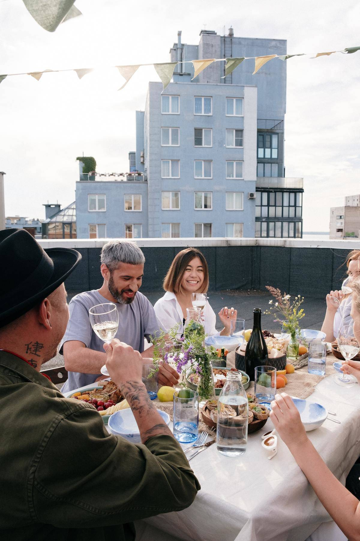 group of people having dinner party on roof