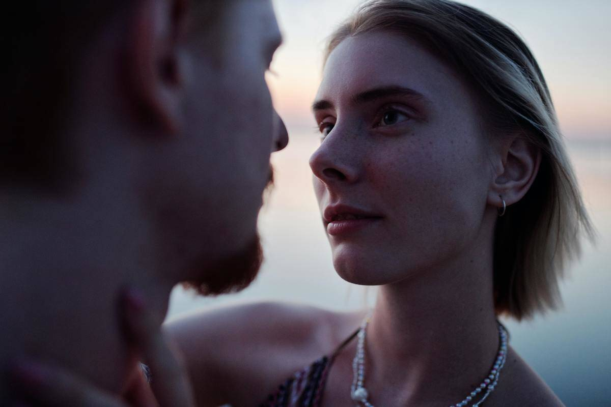 man and woman close and making intense eye contact