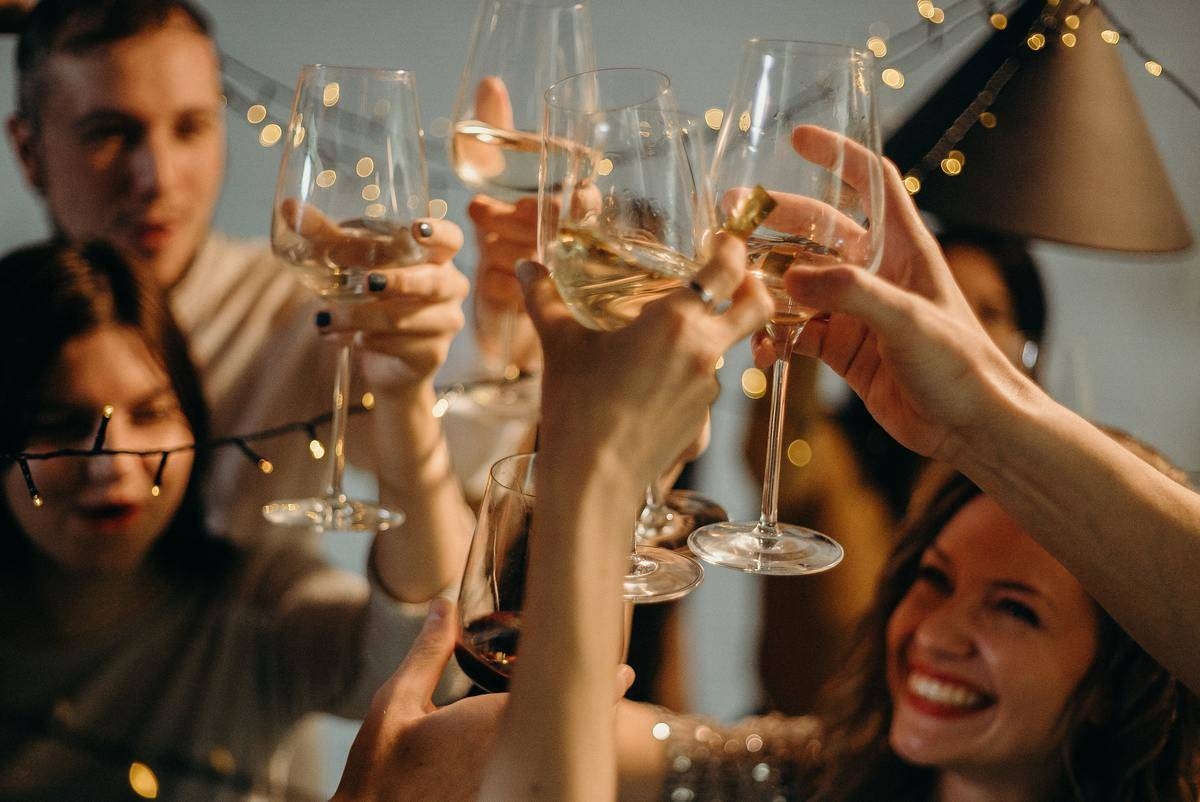friends clinking glasses at party