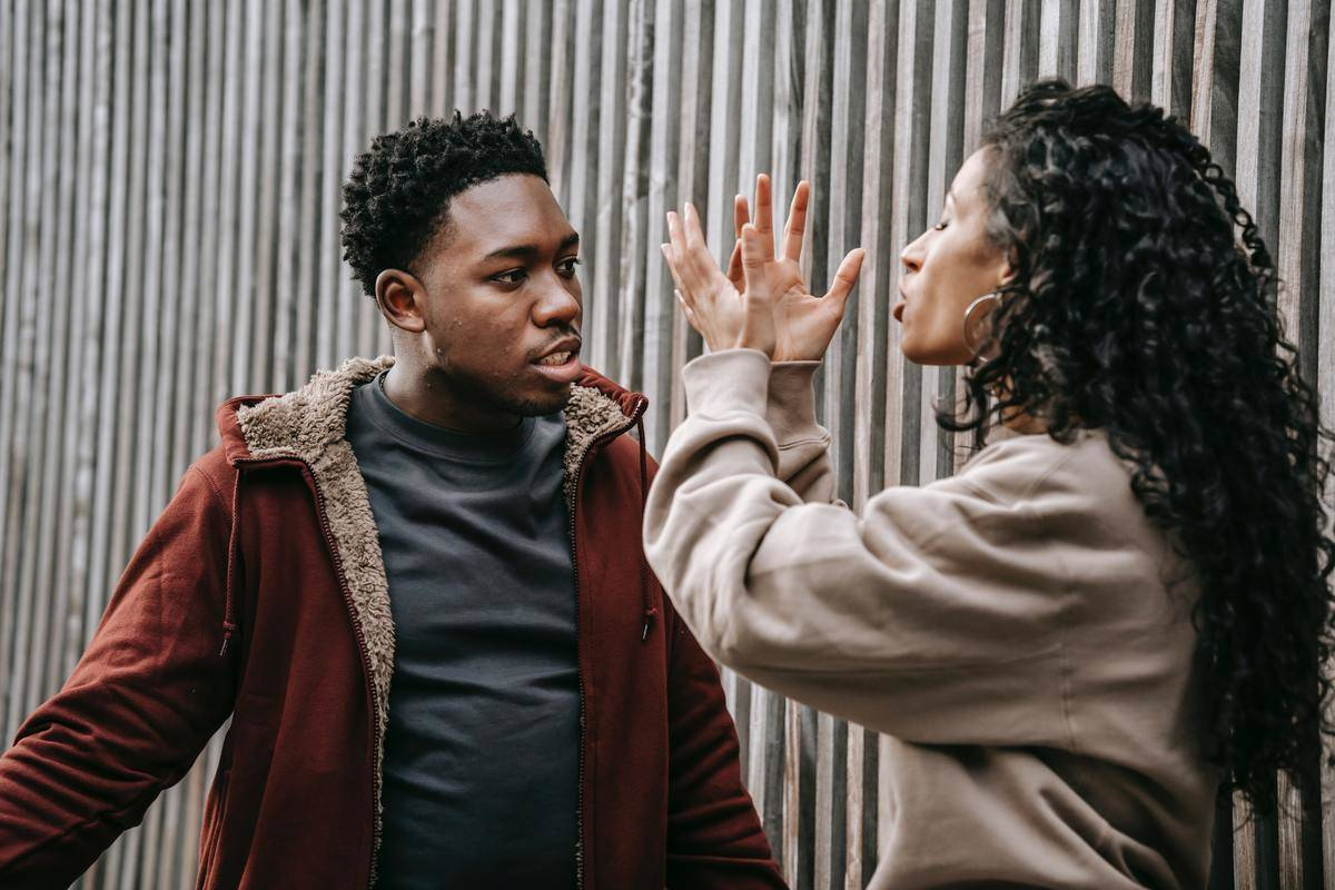 man and woman arguing gesturing with hands
