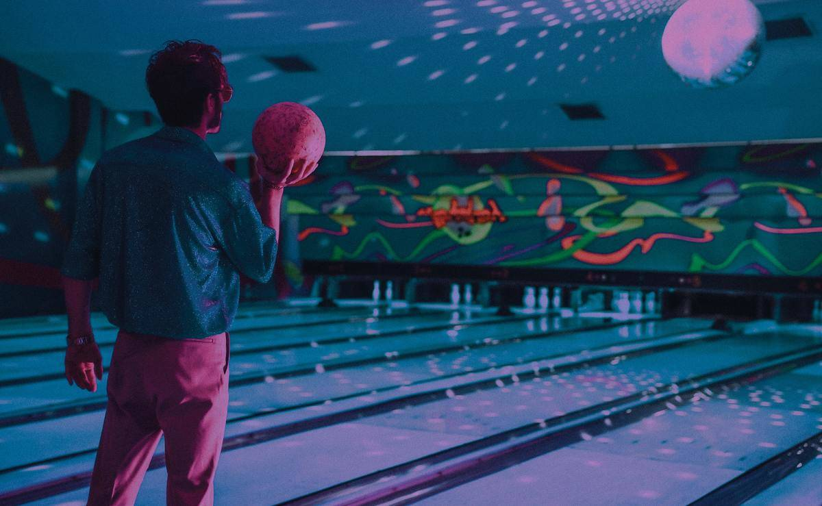 man holding bowling ball ready to throw