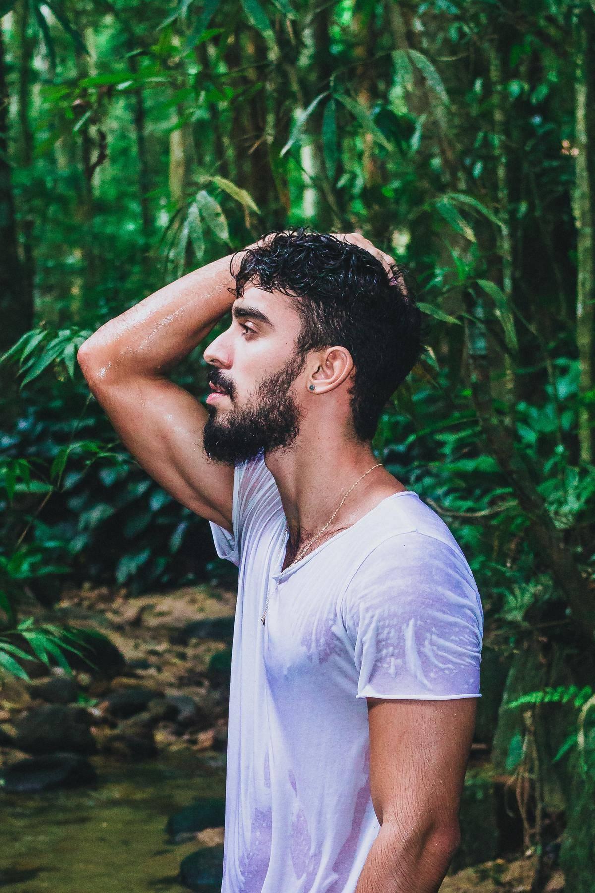 man in sweaty shirt in jungle