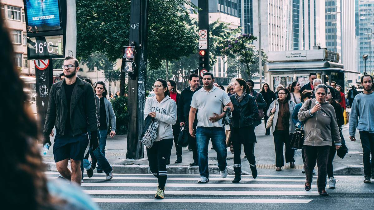 people crossing the street at light