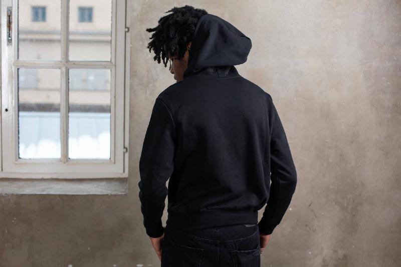 man in black hoodie facing away