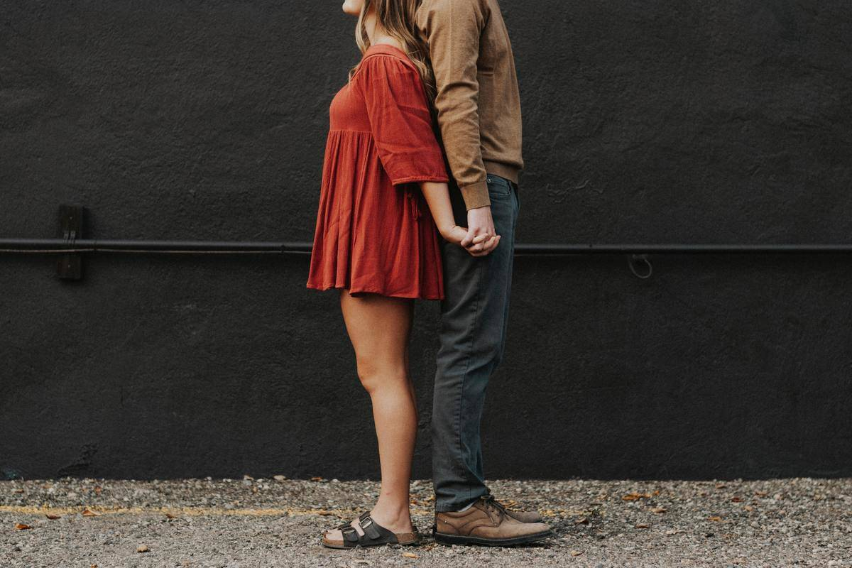 couple back to back outside