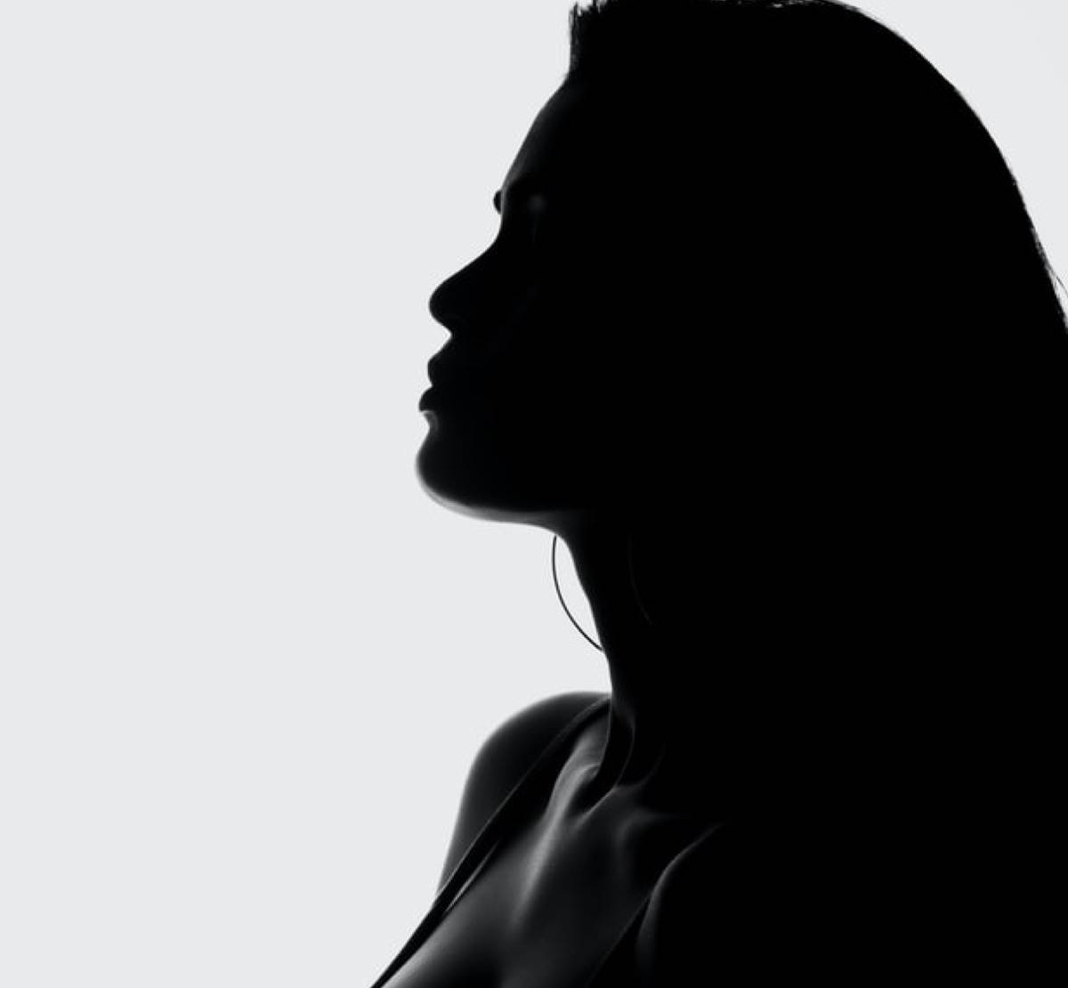 Close up shot of side profile silhouette of woman