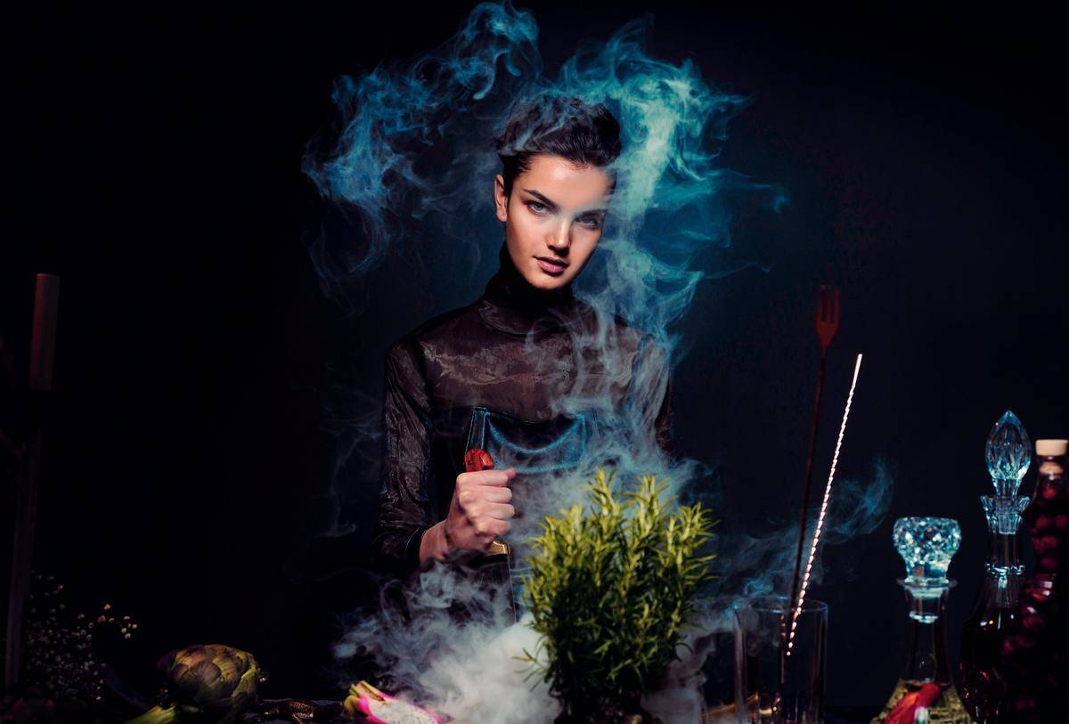 woman cooking in creepy blue smoke