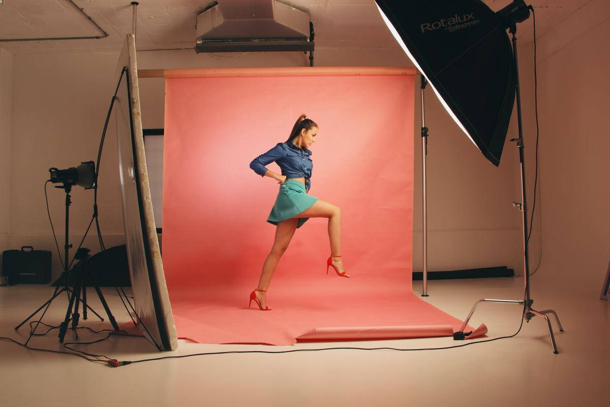 woman in photoshoot posing on one leg