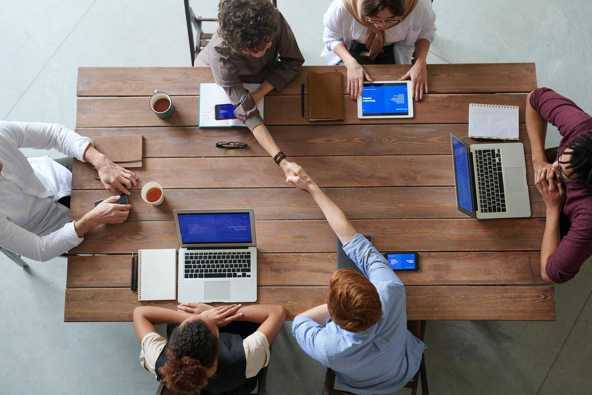 group of people working at meeting table