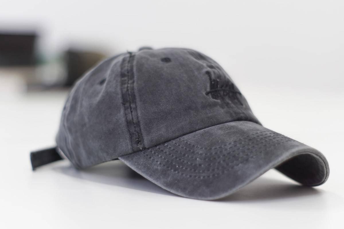 grey baseball cap against a stark white background