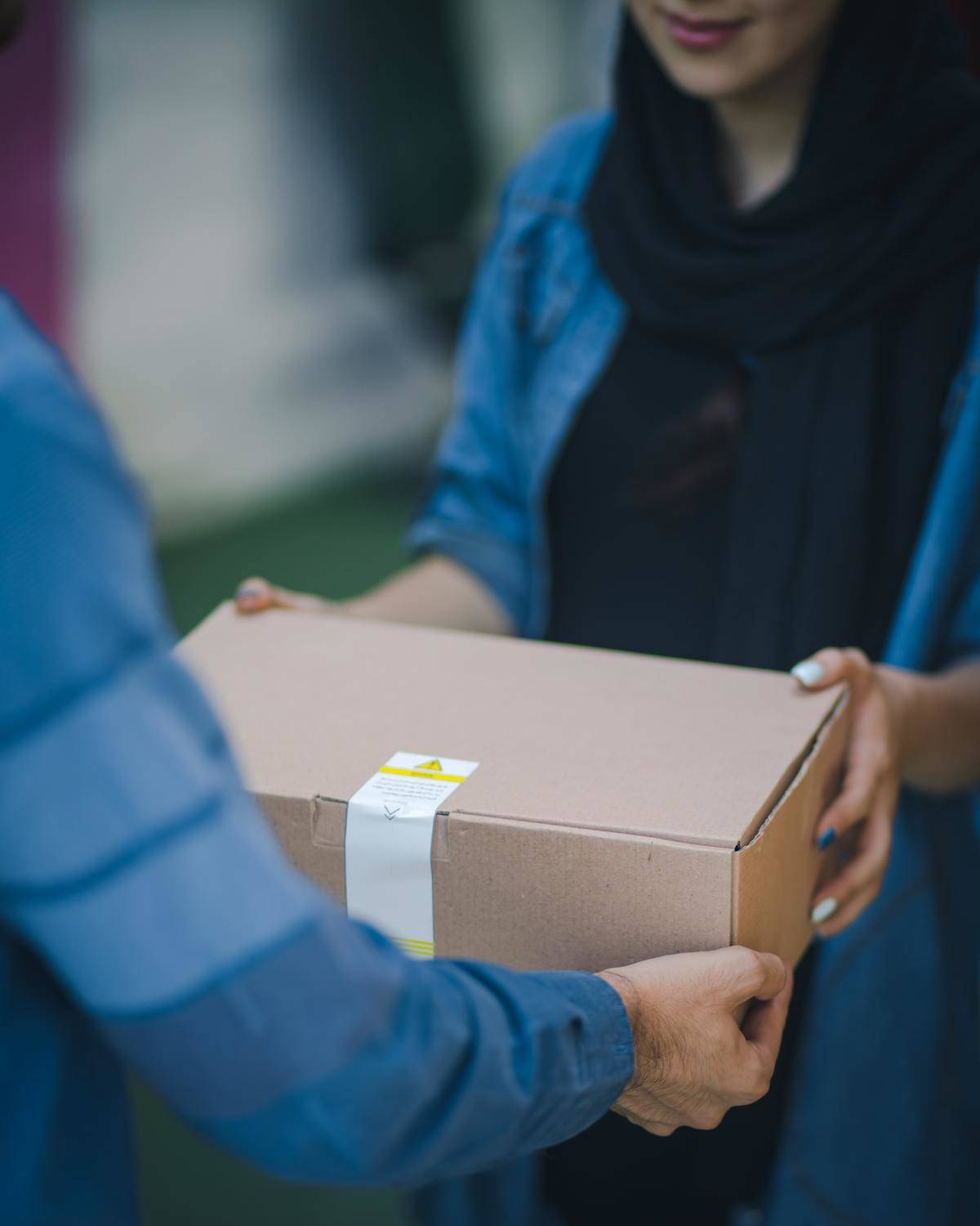 being handed a box by door delivery