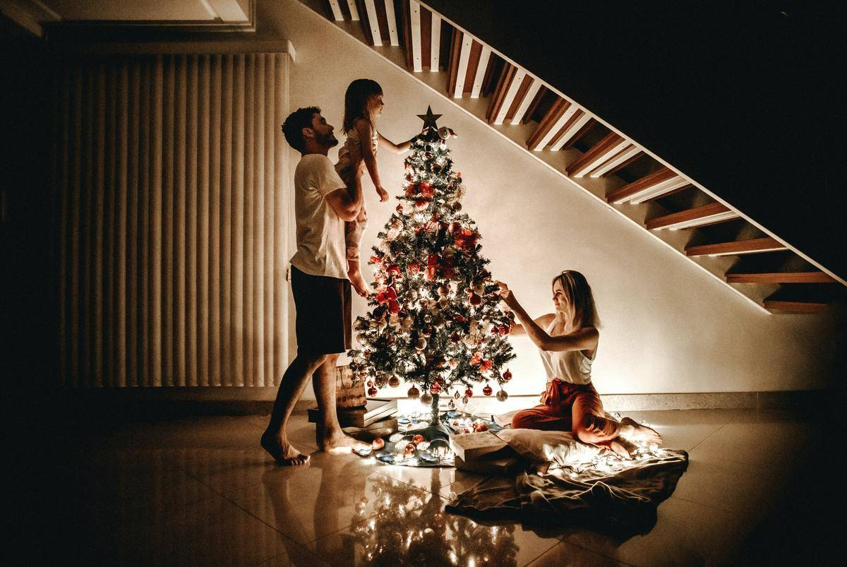 family by the christmas tree