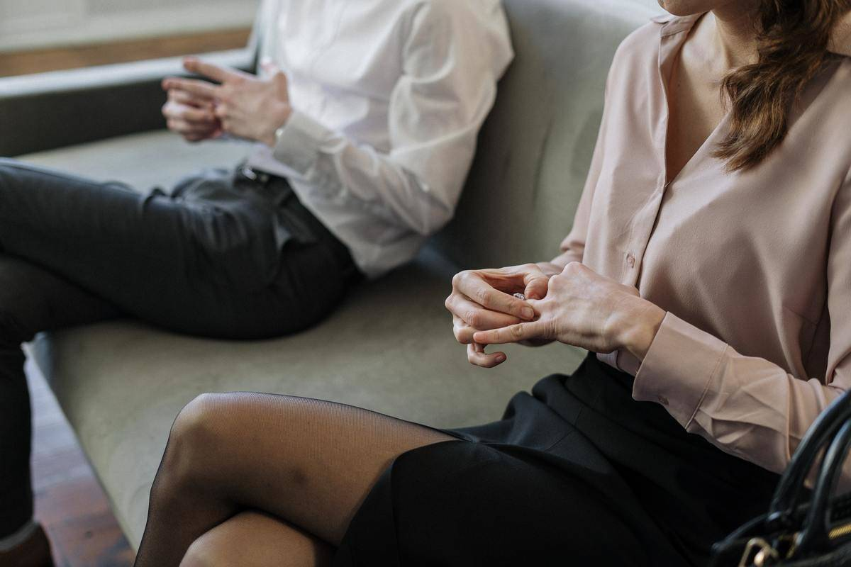 man and woman on couch at counseling