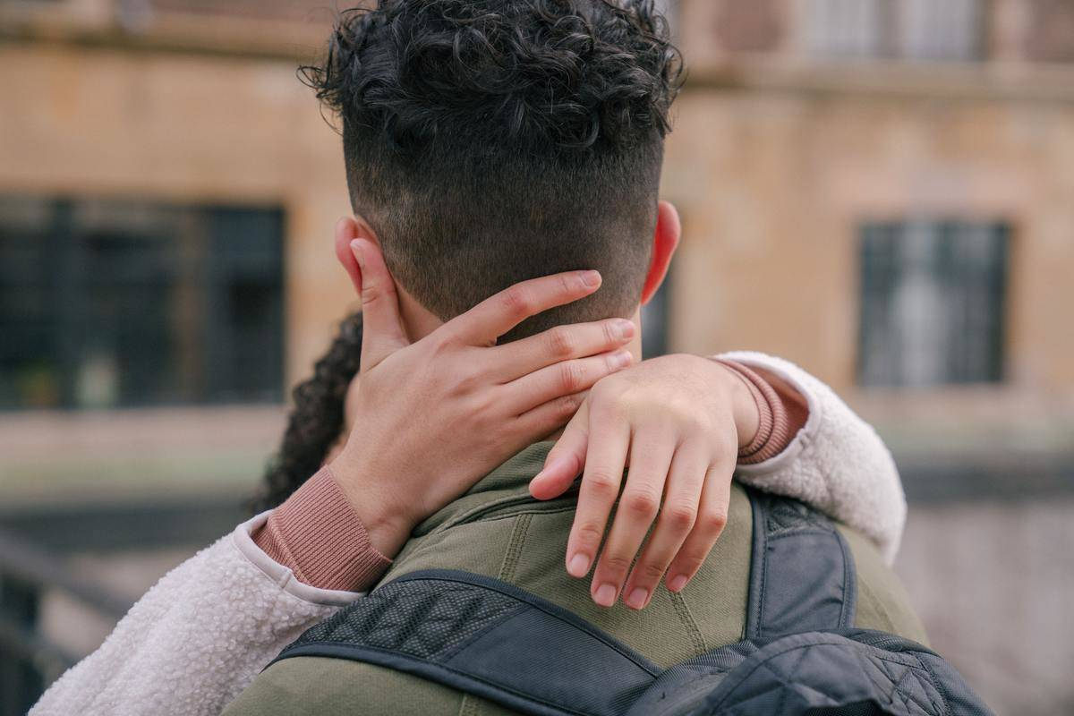 back of man's head while couple is kissing