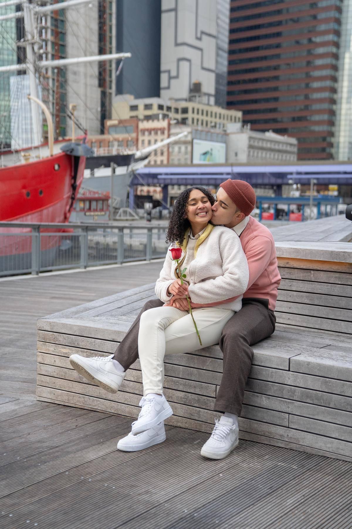 happy couple outside on boardwalk