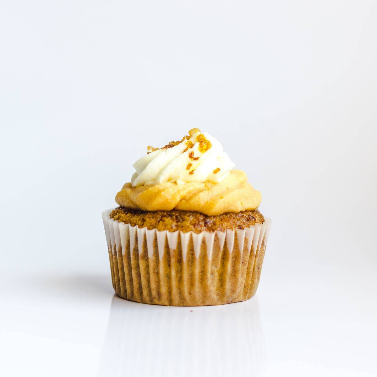 cupcake with yellow and white frosting