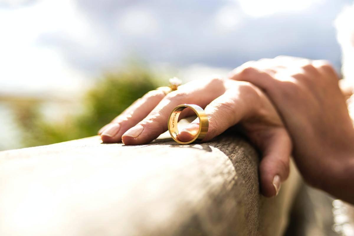 hand holding wedding band