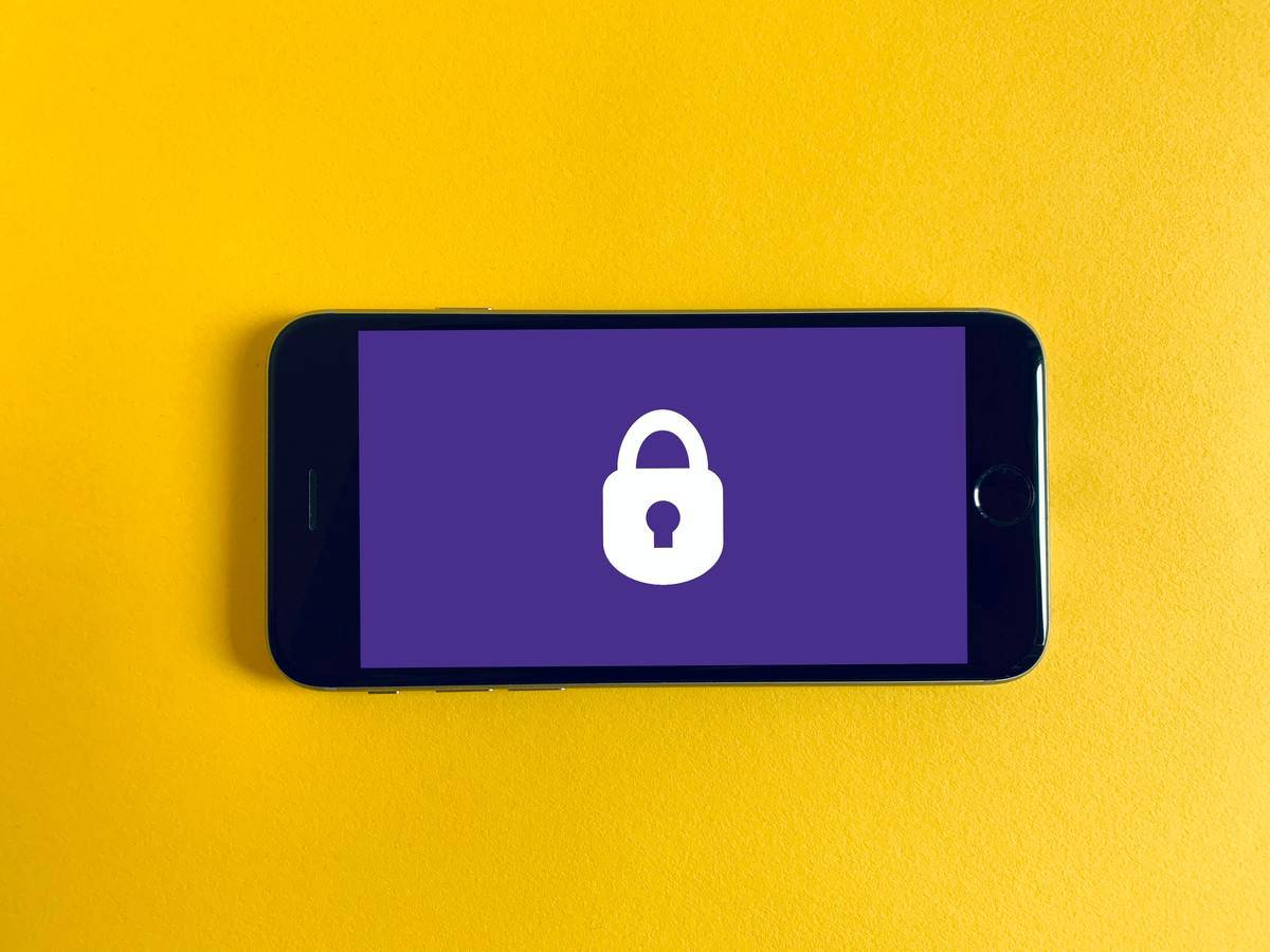 iPhone with a purple background and padlock image on the screen