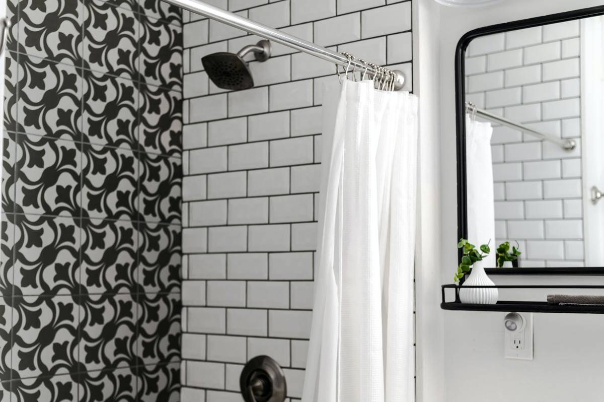shower with black-and-white subway tiles