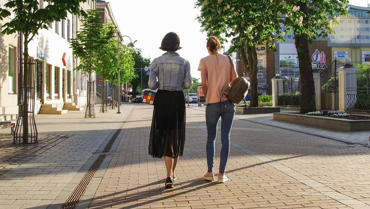 two women walking on the street