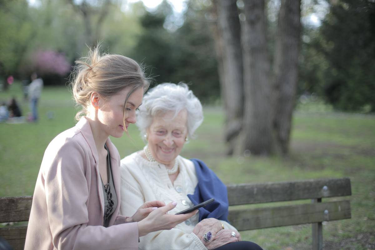 woman and her grandma sitting on a bench in the ark