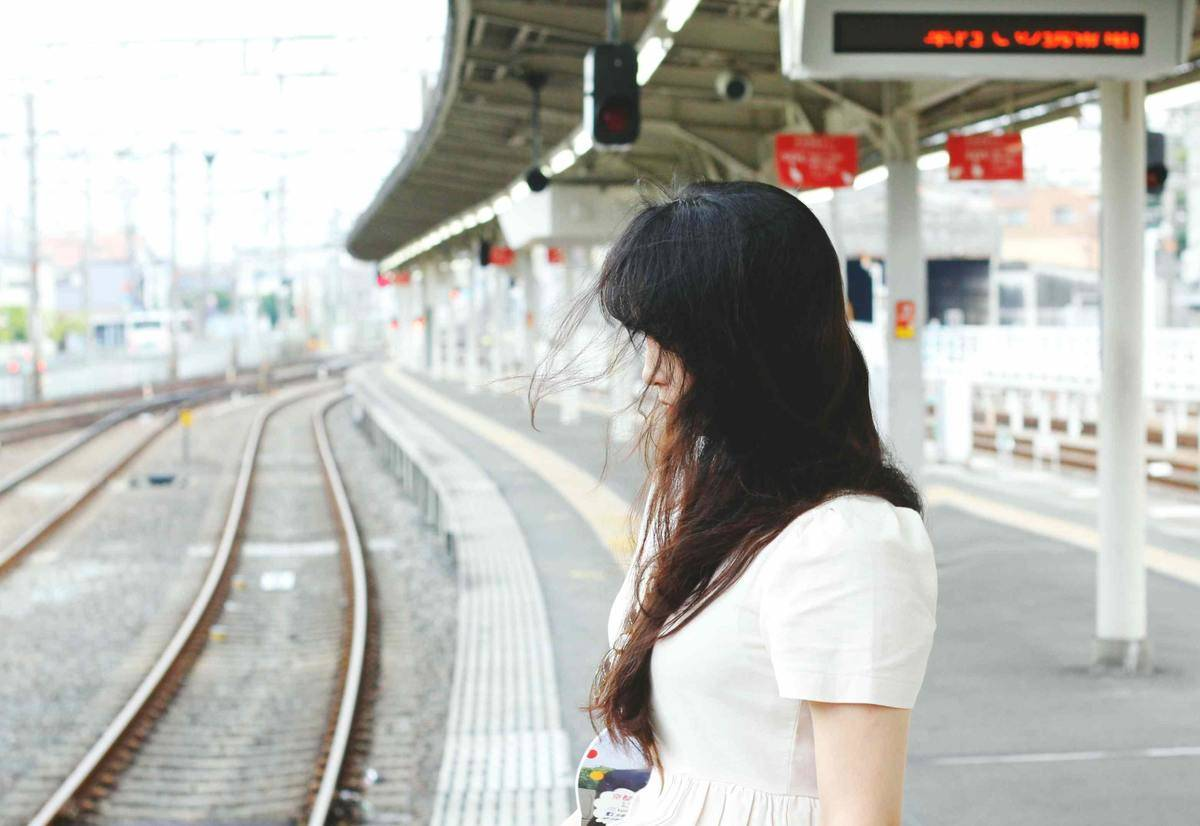 woman at subway station looking down