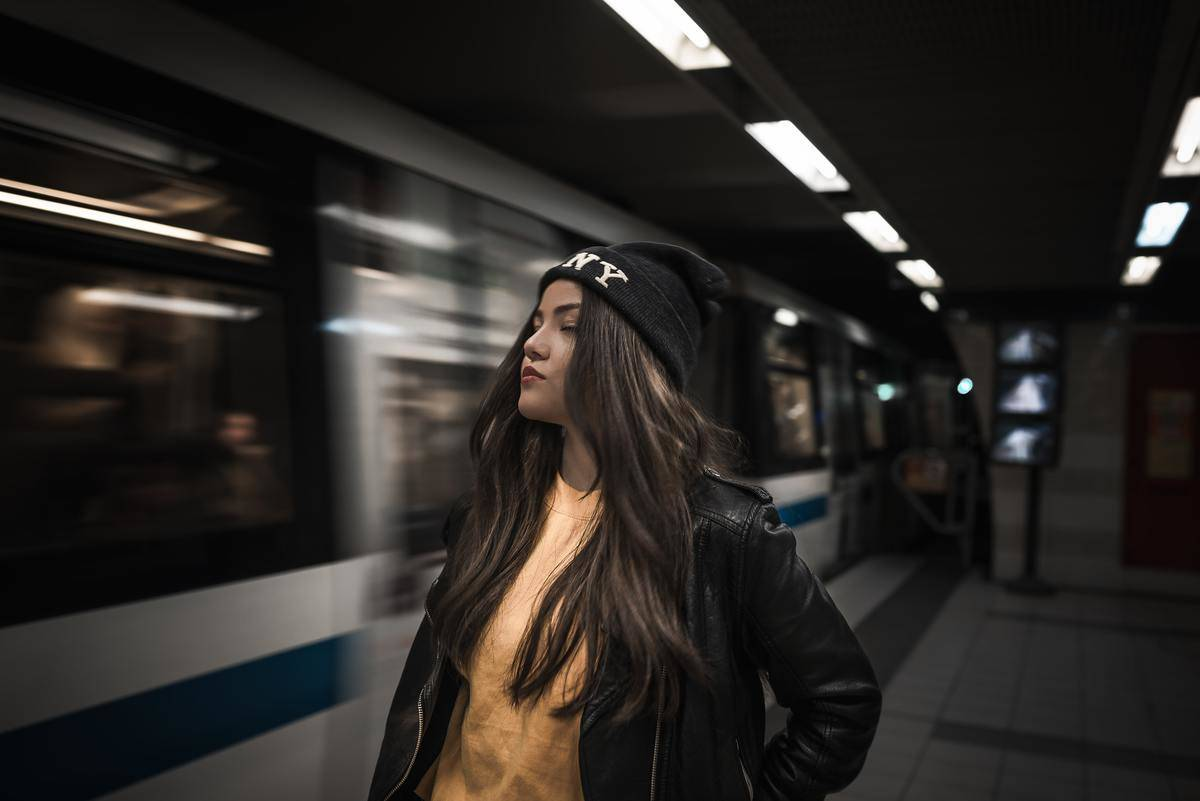 woman standing by the subway