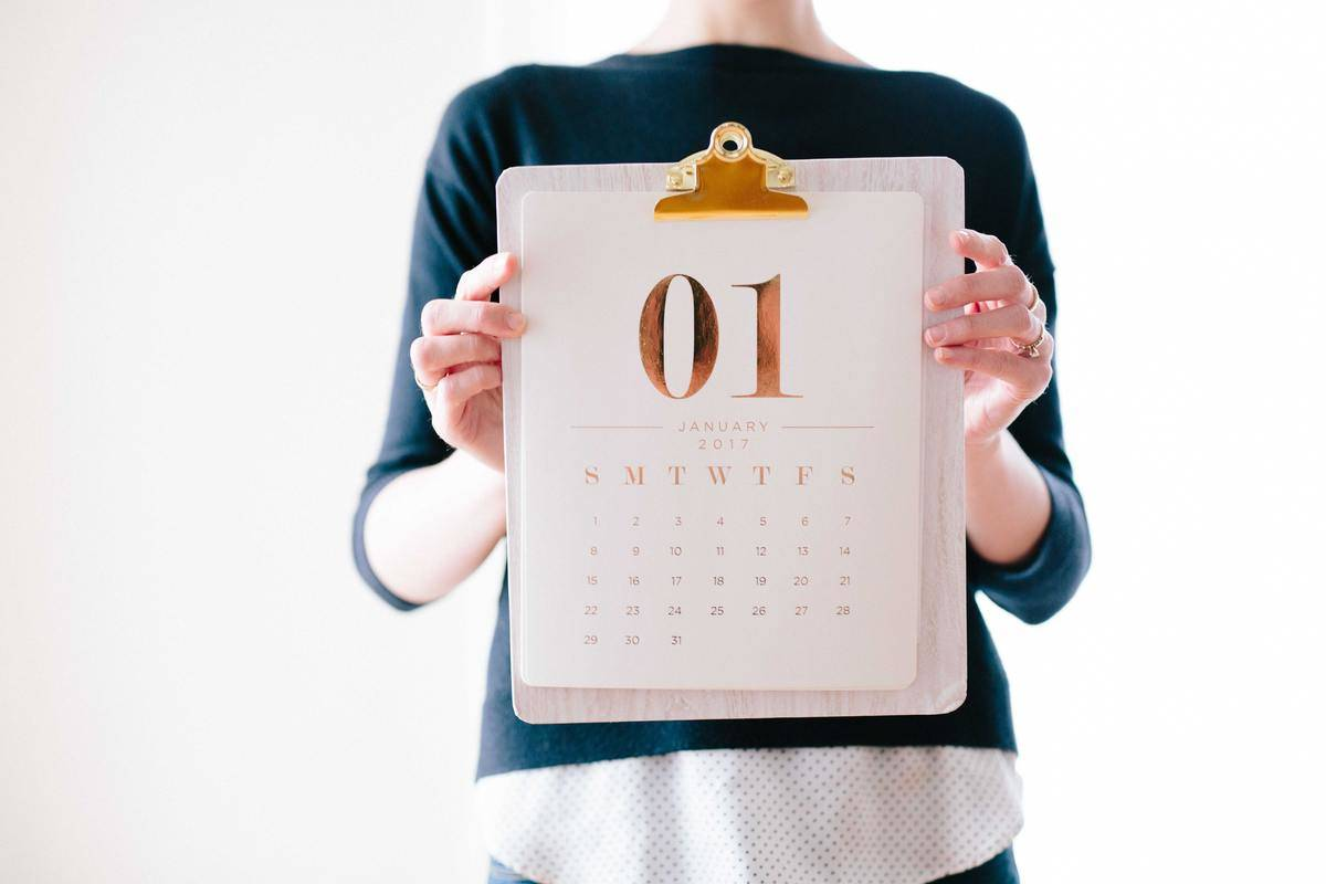 woman holding calendar with month
