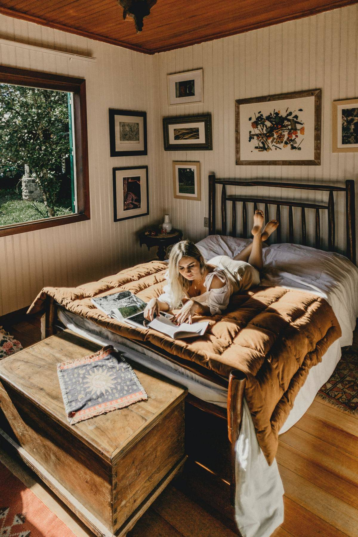 woman reading in bed with feet up