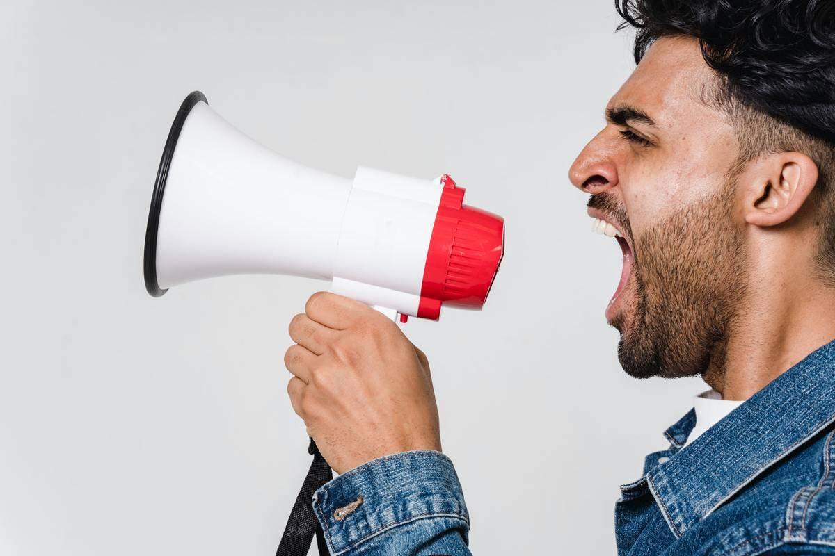 Man shouting into bullhorn