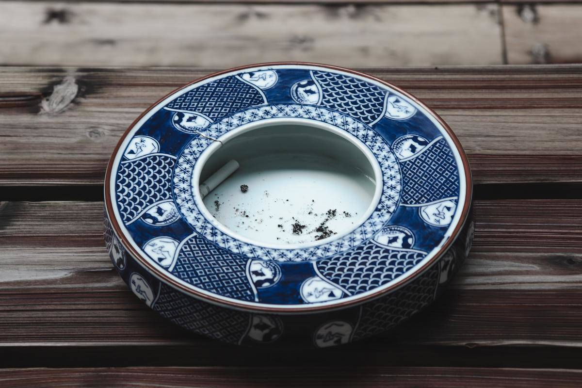 Blue ceramic ashtray with patterns