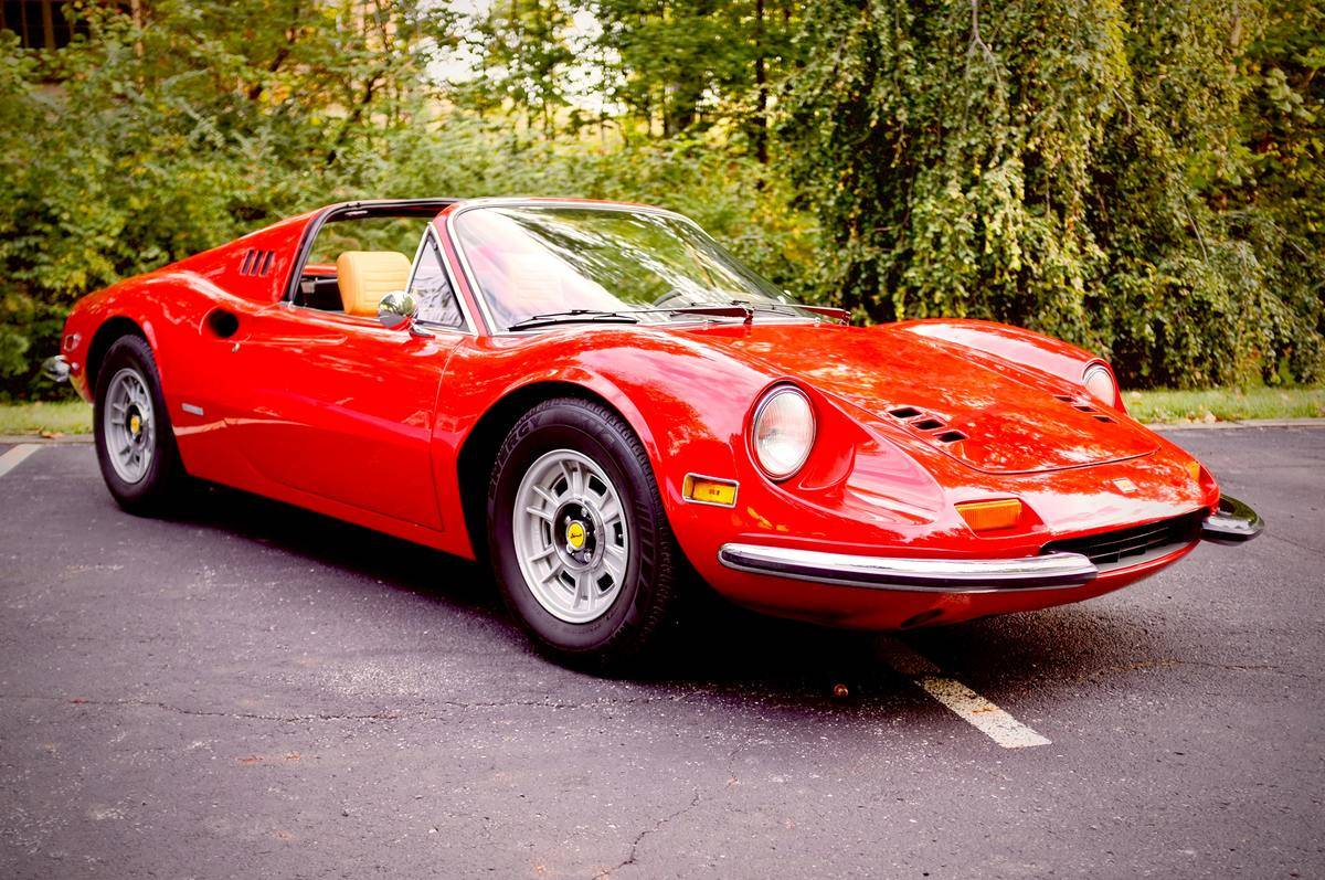 Classic red Ferrari with shiny body, perfect condition, parked outside