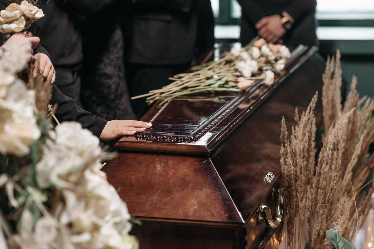 wooden coffin with flowers on top