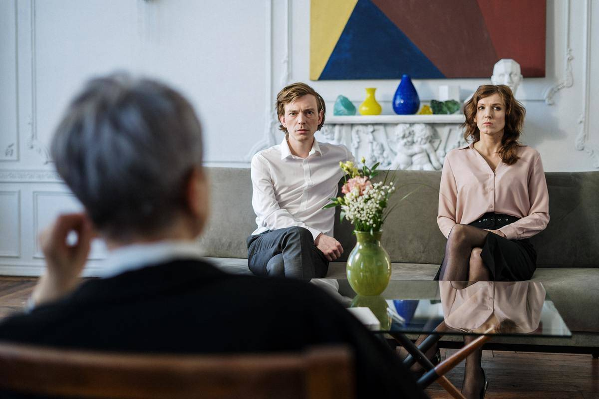 Couples counseling with mediator, couple on couch