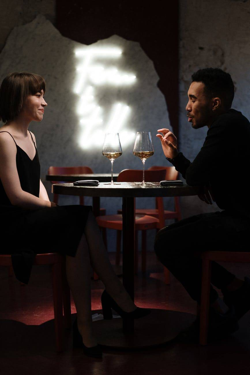 couple dining together in restaurant drinking white wine