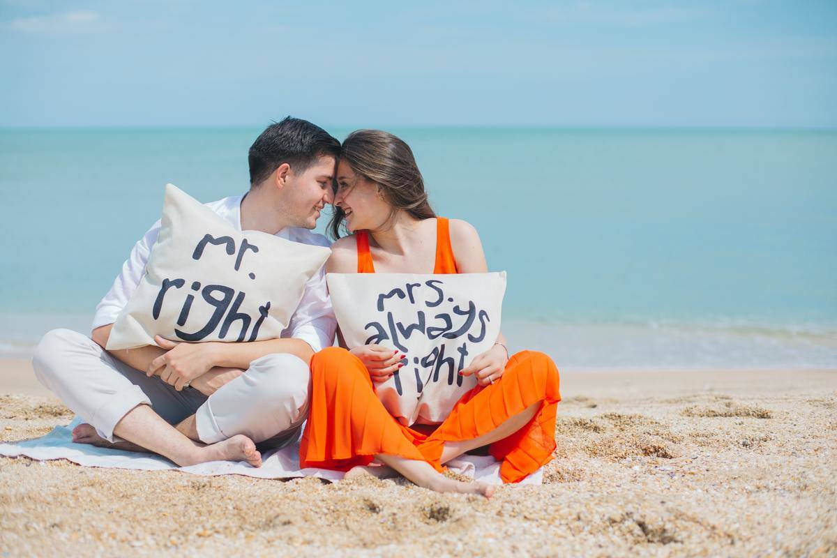 Couple with pillows at beach