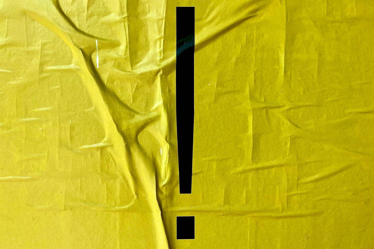 Artistic exclamation point on yellow background