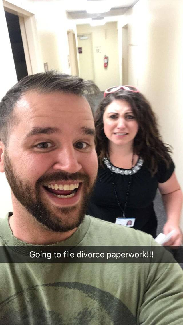 Man smiles in selfie with soon-to-be ex-wife as they go file for divorce