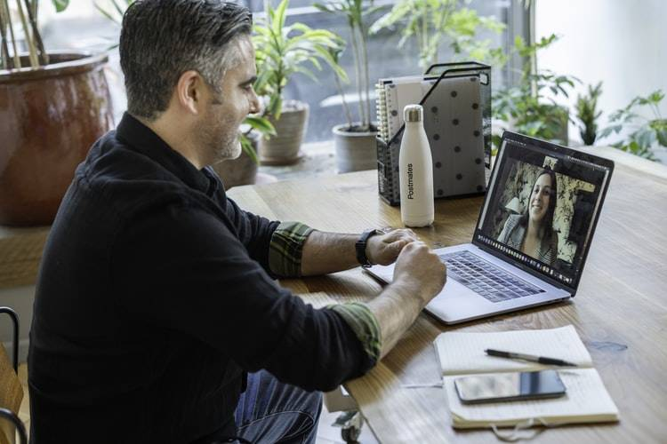man on video call with woman