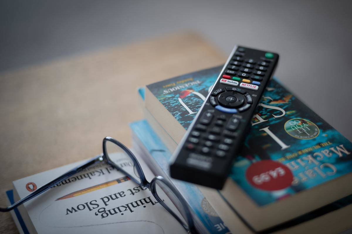 Remote control for TV on books on coffee table