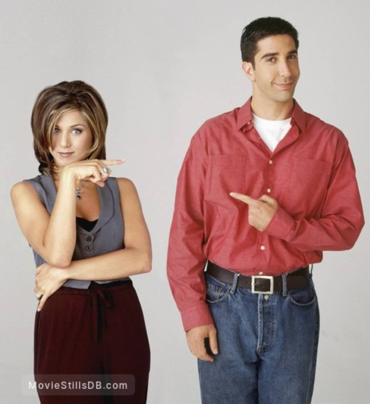 Ross and Rachel from friends pointing fingers at eachother