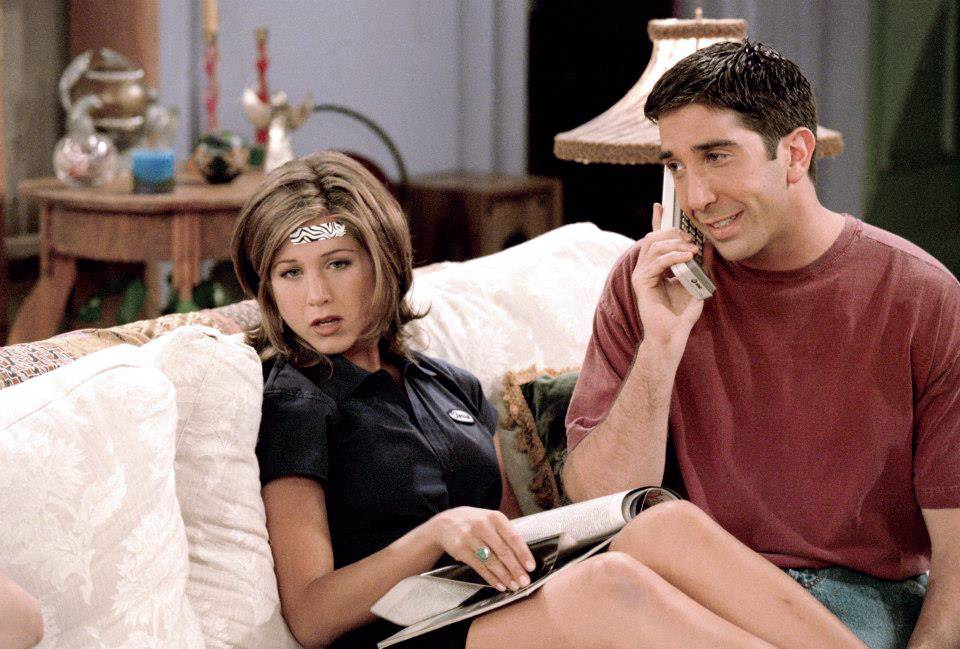 Ross and Rachel in the second season sitting on the couch together