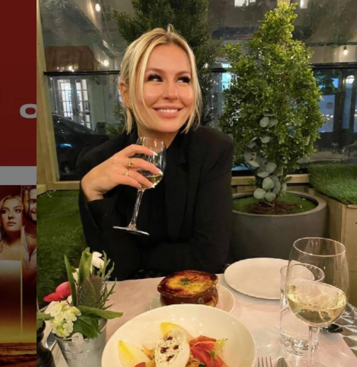 Serena Kerrigan smiling at a restaurant