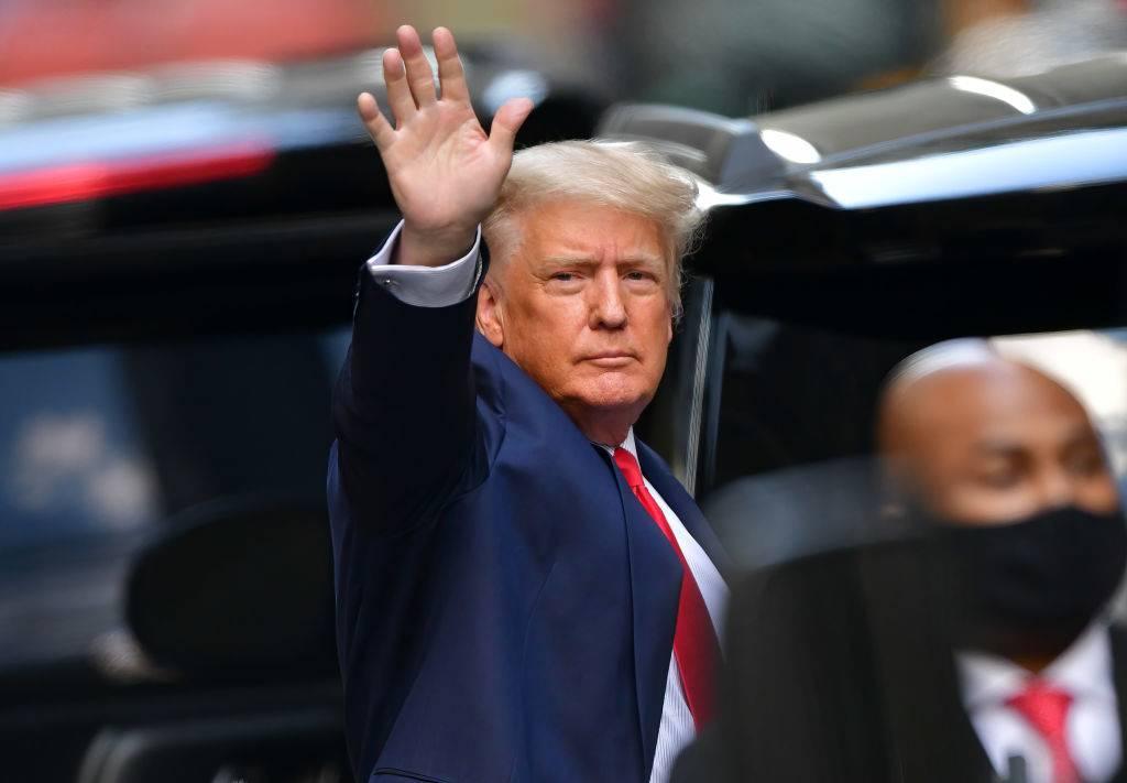 U.S. President Donald Trump leaves Trump Tower in Manhattan waving