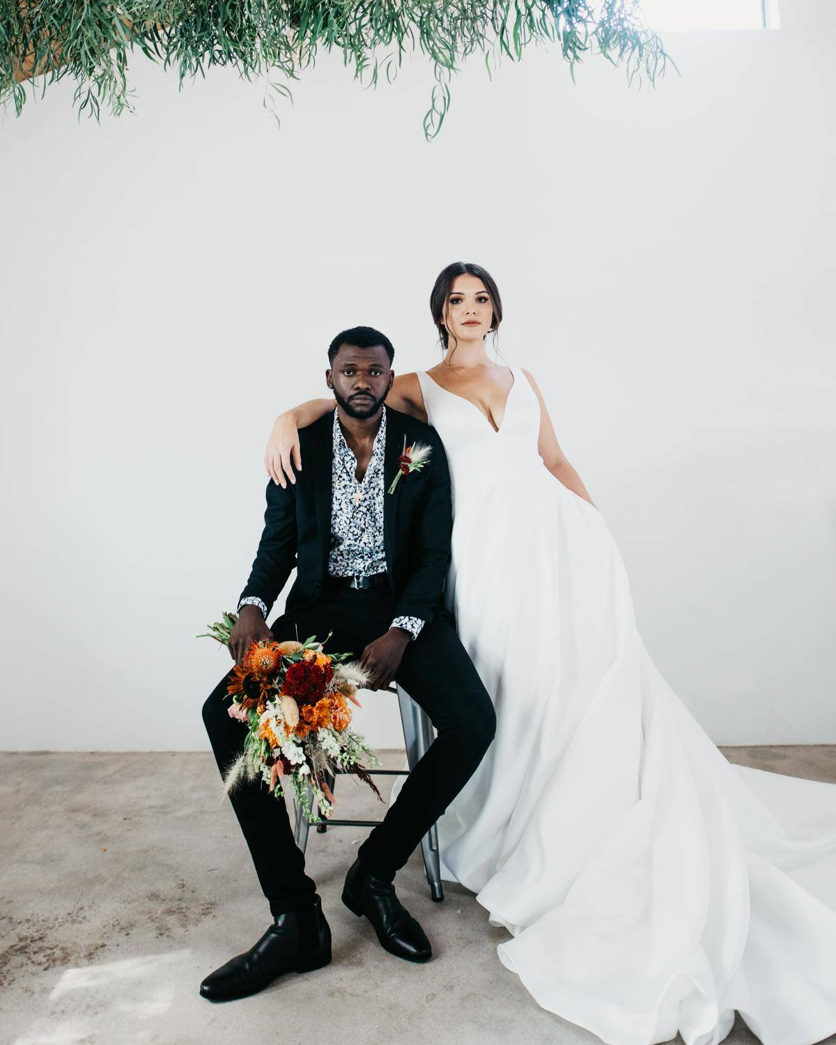 bride and groom sharing a chair