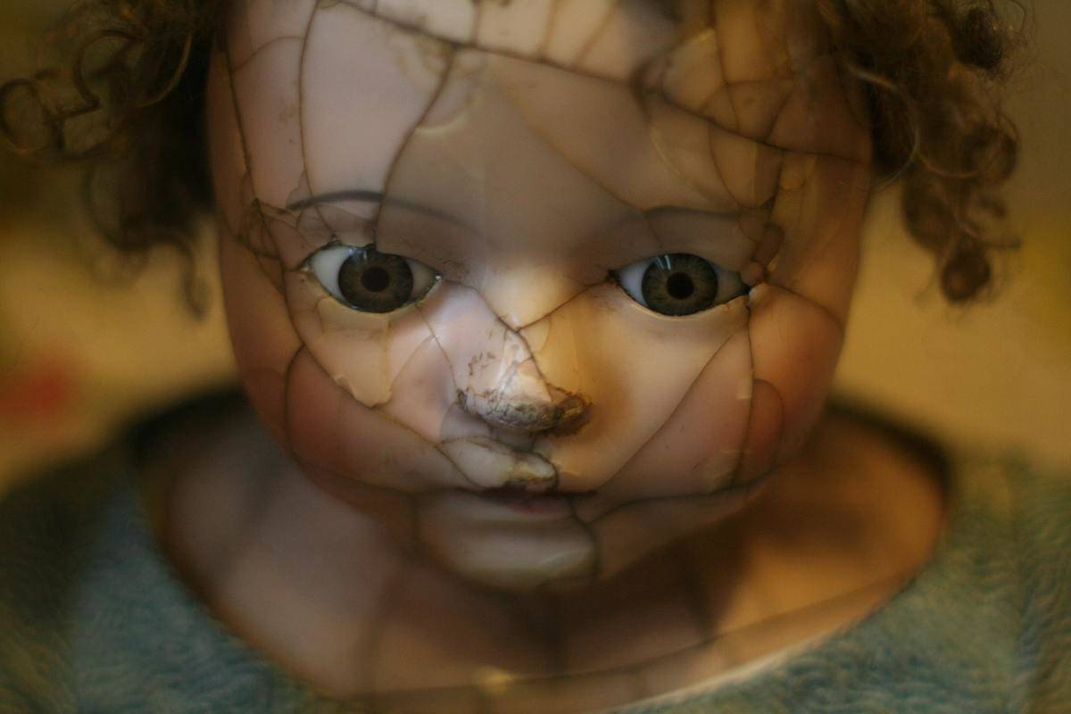 doll with broken face looking creepy