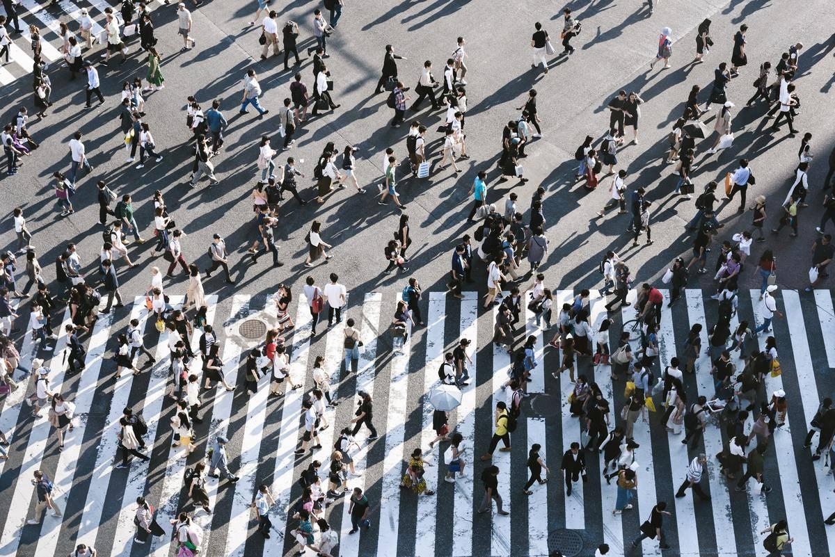 crowd of people crossing street